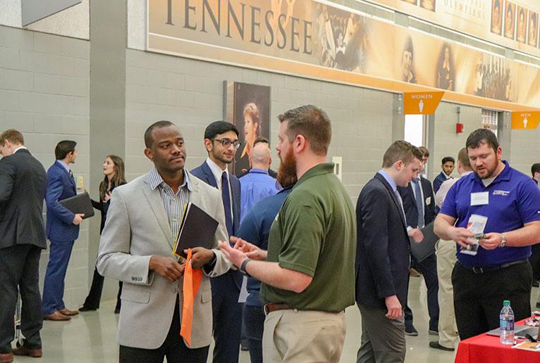 Student Talking to Company Representative at Booth