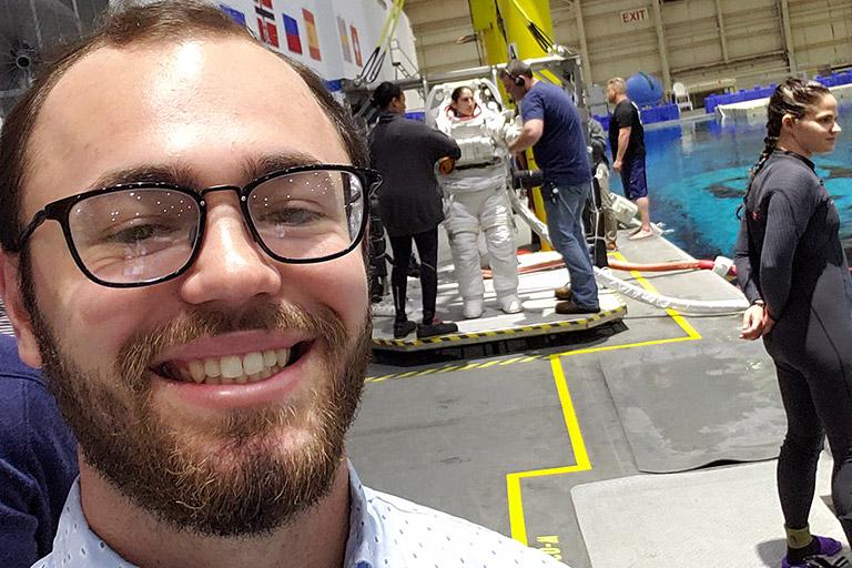 Miller McSwain takes a selfie in front of astronaut Jasmin Moghbeli.