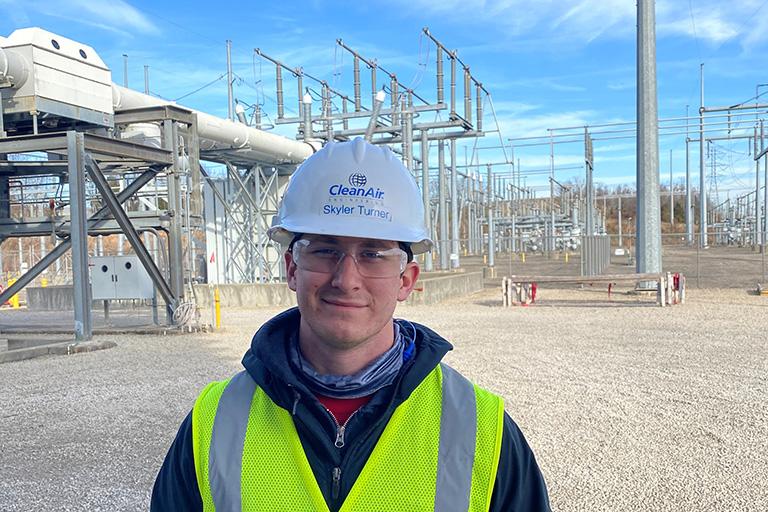 Skyler Turner working in the field for Clean Air Engineering.